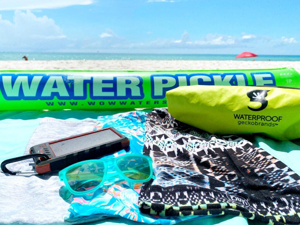 beach float, sunglasses, waterproof bag